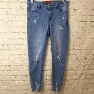 Wax Jeans light jeans with raw hem and distressing